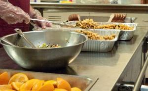 Volunteer serving lunch at the Brethren Nutrition Program